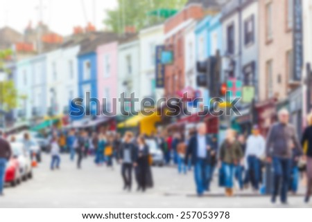 Crowded Portobello road, a famous area in London, blurred background - stock photo