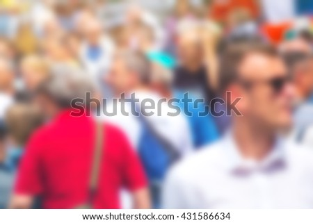 Crowded street as blur background, unrecognizable everyday ordinary people commuting