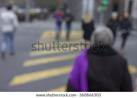 Crowded street, people walking, blurred background