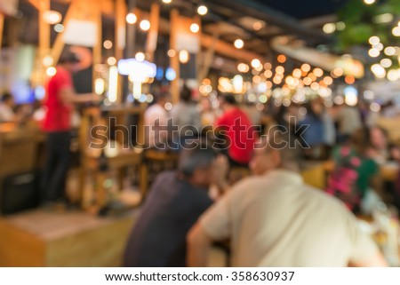 Crowded Traveler in pub at Thailand blur