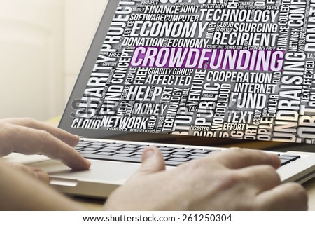crowdfunding concept: man using a laptop with crowdfunding cloud words on the screen - stock photo