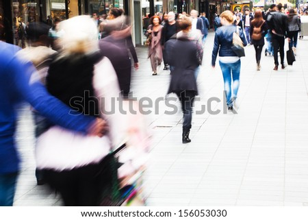 crowds of shopping people walking in the city