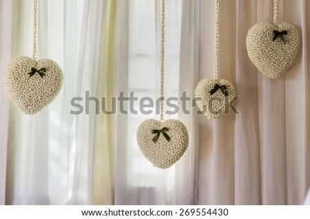 Crown flower hearts decorated on white curtain for Valentine's day - stock photo