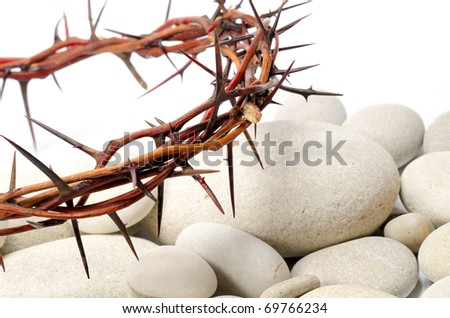 crown made of thorns and white river stones - stock photo