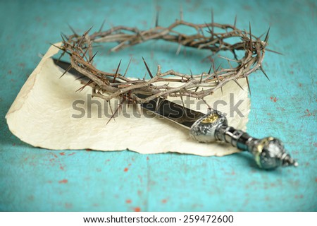 Crown of thorns and Roman sword on vintage paper -Selective focus on crown - stock photo