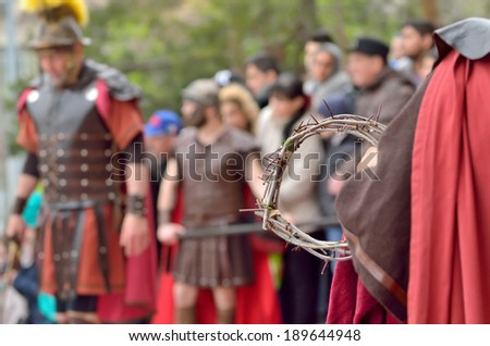 crown of thorns in the hands of a roman soldier - stock photo