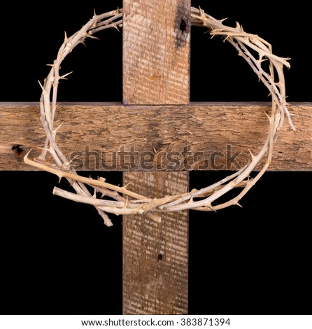 Crown of thorns on a cross isolated on black