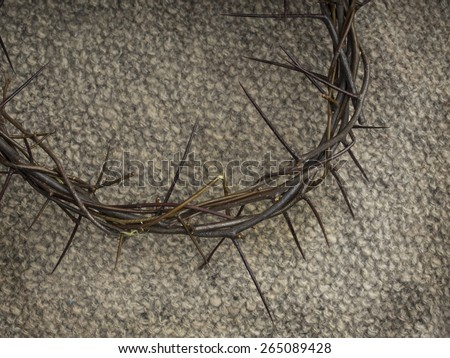 Crown of thorns on burlap background - stock photo