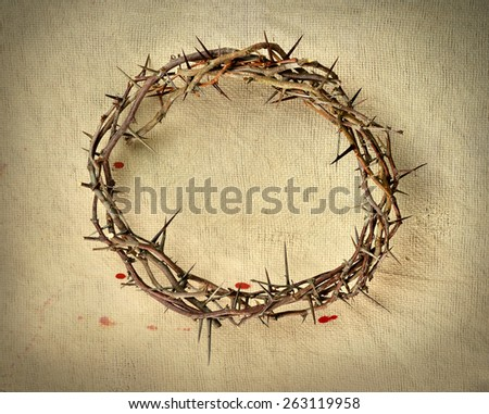 Crown of thorns over vintage cloth with blood drops - stock photo