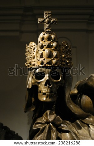 Crowned skeleton in the ancient emperor tombs Kaisergruft in Vienna, Austria.                 - stock photo