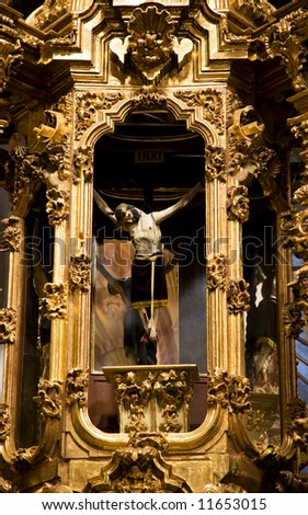 Crucified Jesus hanging from cross, golden altar, Templo De San Cayetano, Valencia Church, Guanajuato, Mexico. This church was finished in 1788 and is named after the nearby Valencia mine. - stock photo