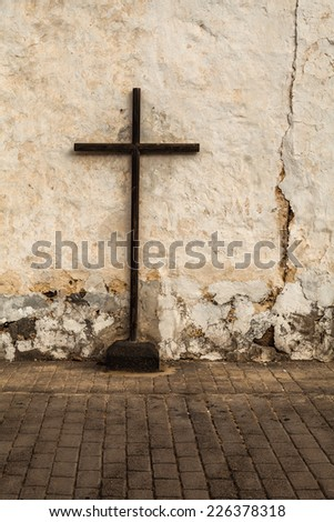 Crucifix in old street. Lanzarote, Canary Islands, Spain. - stock photo