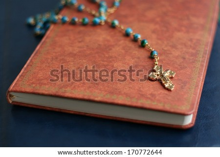 Crucifix on Holy Bible  - stock photo