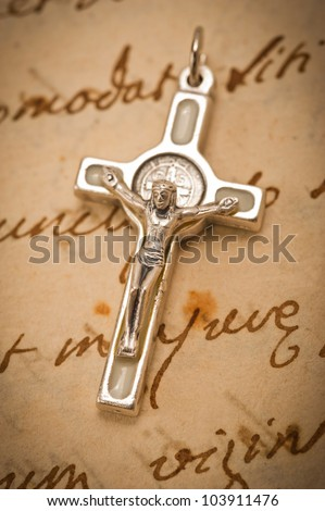 crucifix on old parchment