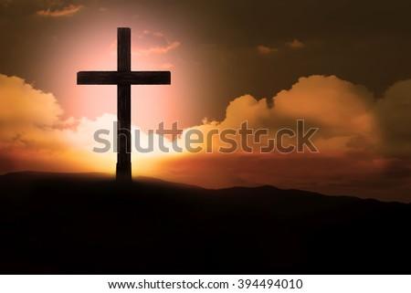 Crucifix with bright sun  - stock photo