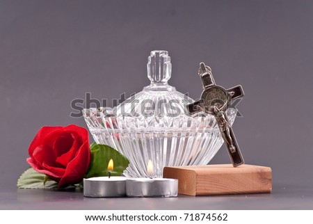 Crucifix with Holy Water in Large Crystal Dish - stock photo