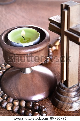 Crucifix with Lit Tea Candles on Bible,close up photo - stock photo
