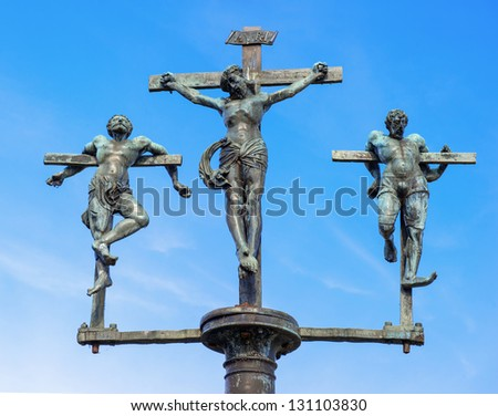 crucifixion of Jesus Christ, INRI, sculpture on the bridge to the Insel Mainau, Lake Constance, Baden-Wuerttemberg, Germany, Europe - stock photo