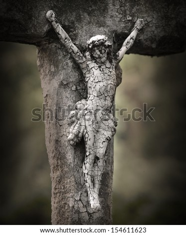 Crucifixion of Jesus. Close up of ancient cross at the abandoned grave.