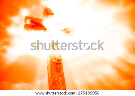 crucifixion of Jesus with dramatic sky background - stock photo