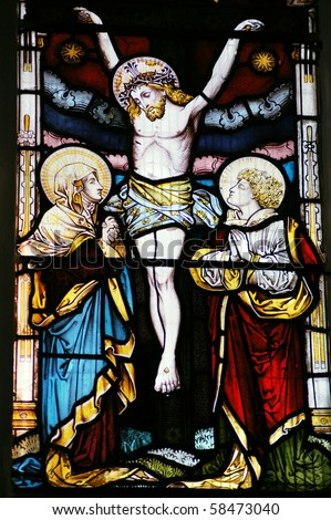 Crucifixion The Crucifixion of Christ depicted in a Victorian stained glass window over 100 years old.  On public display in Saint Mary Magdalene and Saint Denys Church, Midhurst, West Sussex. - stock photo