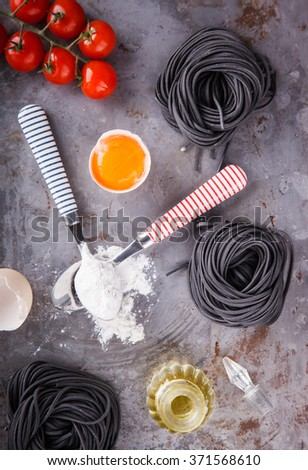 Crude black paste and the ingredients are homemade,spaghetti italian food.selective focus. - stock photo