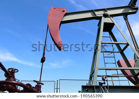 crude oil  jack pump under blue sky in europe - stock photo