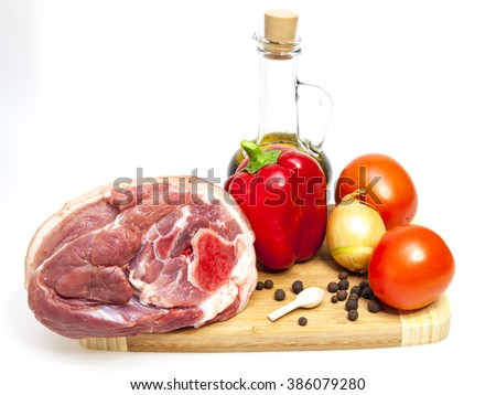 Crude pork hough, vegetables, spices and kitchen utensils  - stock photo