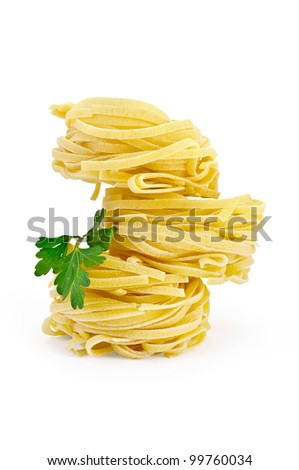 Crude twisted noodles with parsley isolated on white background - stock photo
