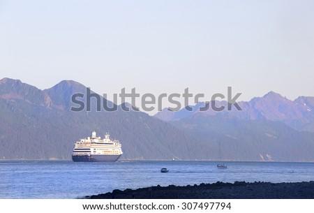 Cruise boat leaving Seward harbor, Alaska - stock photo