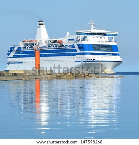 cruise ferry ship sailing in still water - stock photo