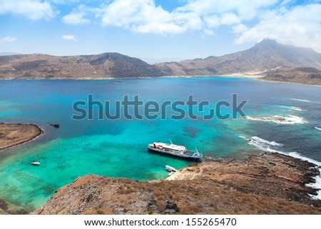 Cruise liner in beautiful lagoon with turquoise water, Gramvousa island, Greece  - stock photo