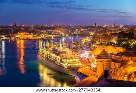 Cruise liner in the port of Valletta - Malta - stock photo
