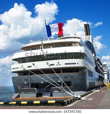Cruise liner Pacific Princess with French flag in sea commercial port of Odessa, Ukraine.  - stock photo