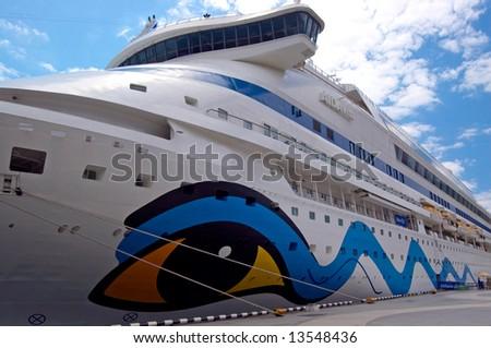 Cruise ship anchored in a pier - stock photo