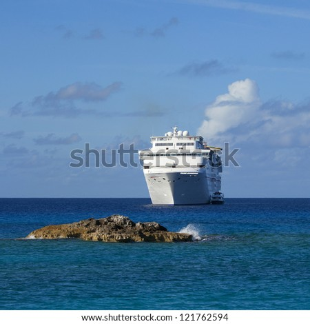 cruise ship anchored off the coast of the bahamas - stock photo