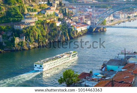 Cruise ship arrives to Porto by the river Douro. Portugal
