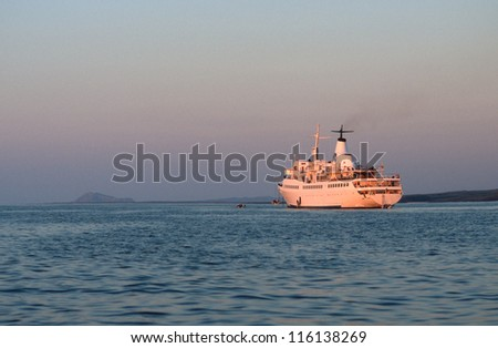 Cruise ship at anchor at sunset in Ecuador