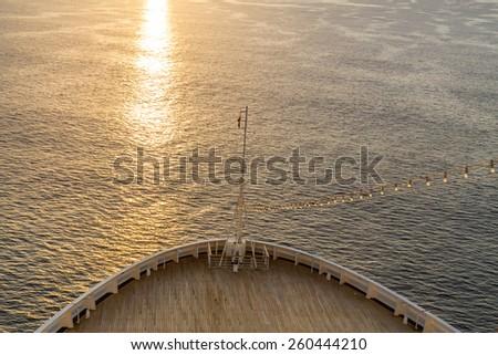 Cruise ship at sunrise - stock photo