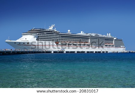 Cruise ship at the docks letting people off. - stock photo