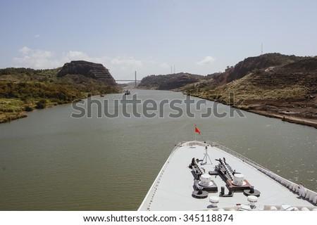 Cruise ship bow passing Panama Canal near the bridge. - stock photo