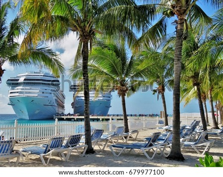 Cruise ship docked at a tropical island