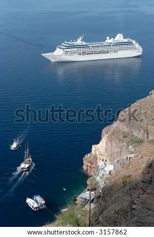 Cruise ship in a mediterranean bay - stock photo