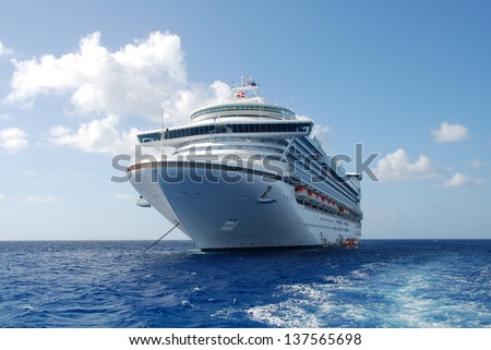 Cruise ship in open water front view