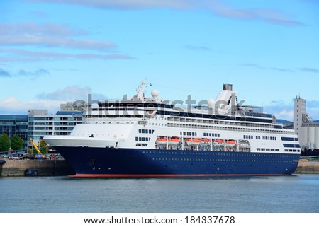 Cruise ship in river in Quebec City with blue sky. - stock photo