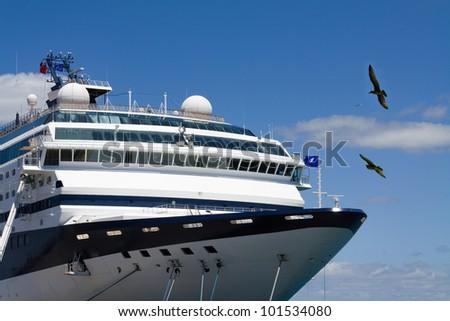 Cruise ship in the sea port - stock photo