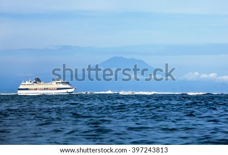 cruise ship in the sea with island