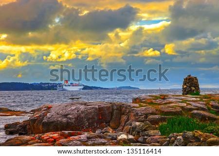 Cruise ship leaving Stavanger, Norway. - stock photo