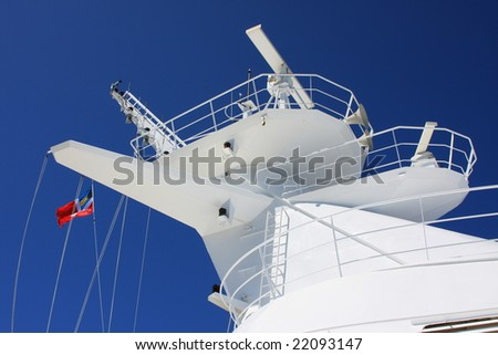 Cruise ship mast and red flag