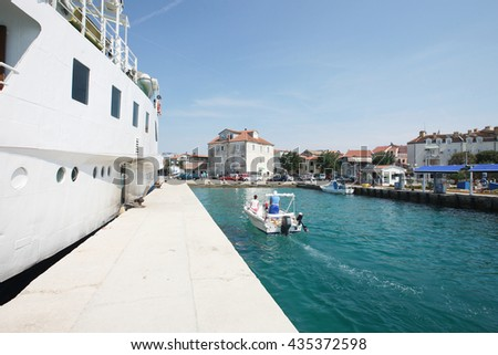 Cruise ship moored to a dock at resort - stock photo